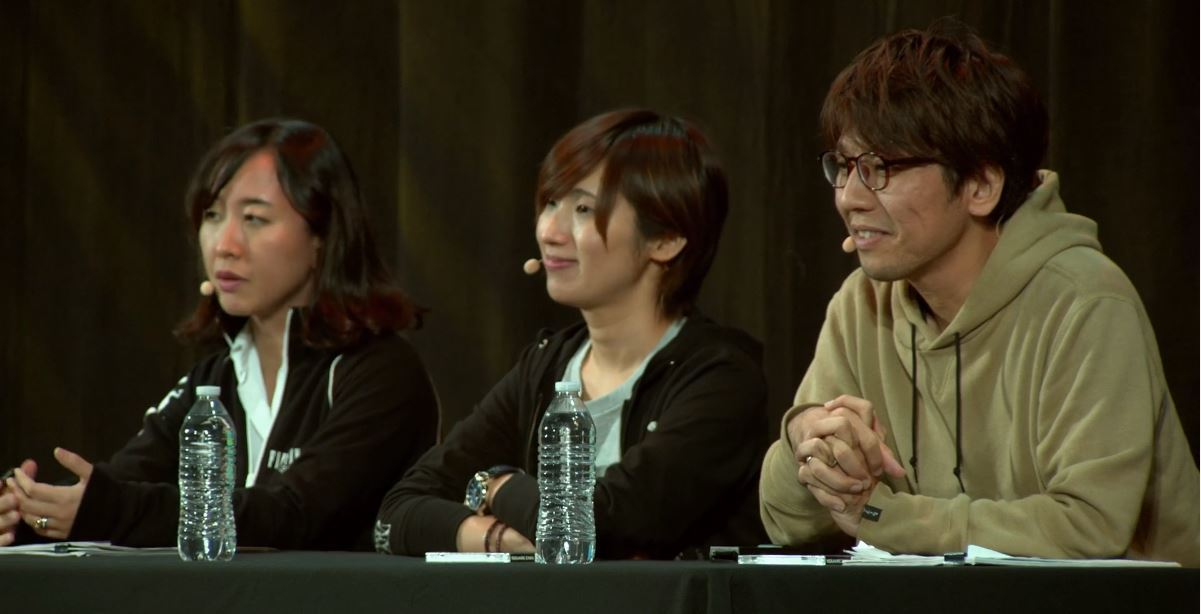 Natsuko Ishikawa (center) and Takeo Suzuki (right) during the Shadowbringers Post-mortem at PAX West 2019. (credit: PAX)